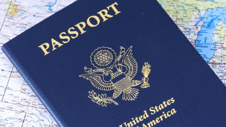 US passport sitting on a map