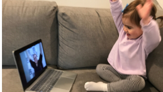 toddler hands up watching librarian with hands up on laptop