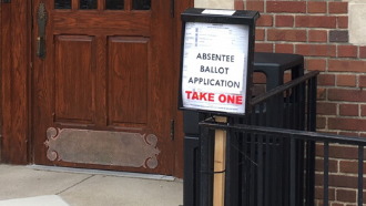 ballot applications in box outside library door